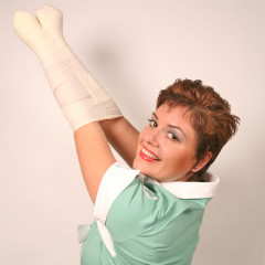 Here Nurse Mona is has her arms tightly bound with our white vet wrap